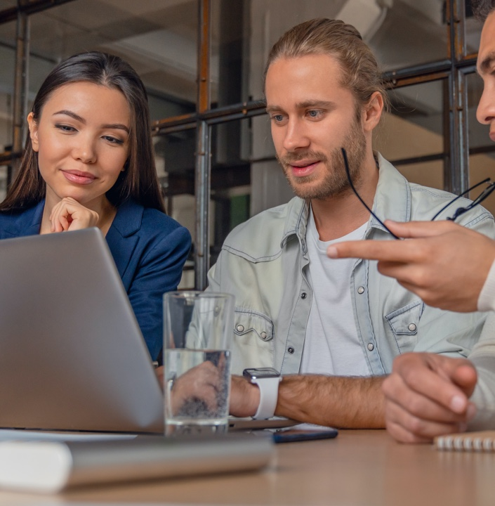 Three people having a meeting around security solutions